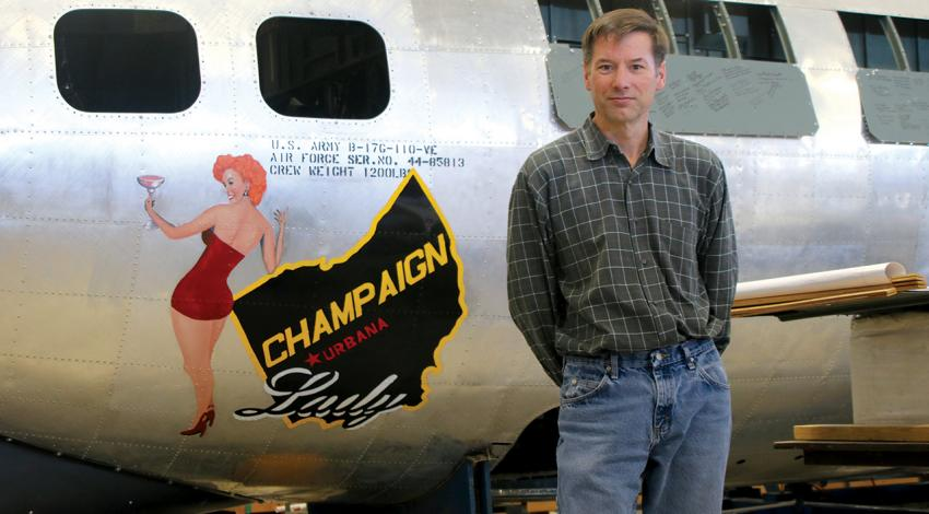 Dave Shiffer poses with Champaign Lady in the museum's hangar.