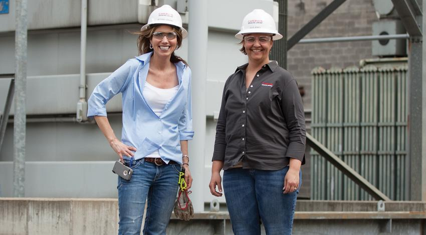 Cardinal Plant Manager Bethany Schunn and Sustainability Lead Julie Jones smile together for a picture.