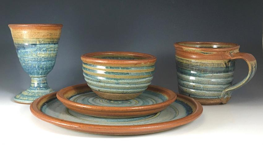 A collection of pottery bowls, plates, and cups.