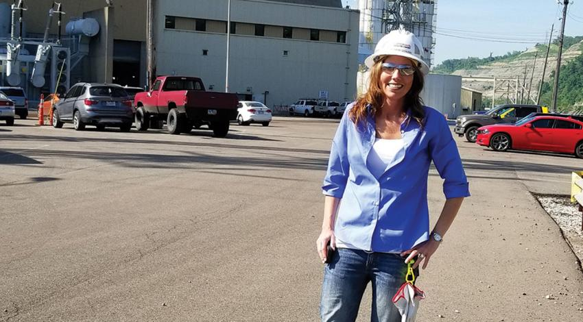 Bethany Schunn, plant manager for Cardinal Power Plant, smiles for a photo.