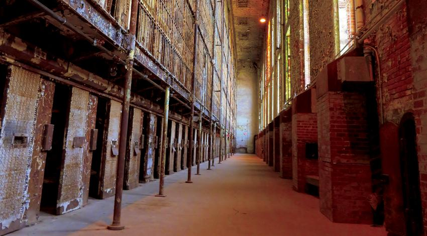 An inside view of the Ohio State Reformatory featuring old cells.