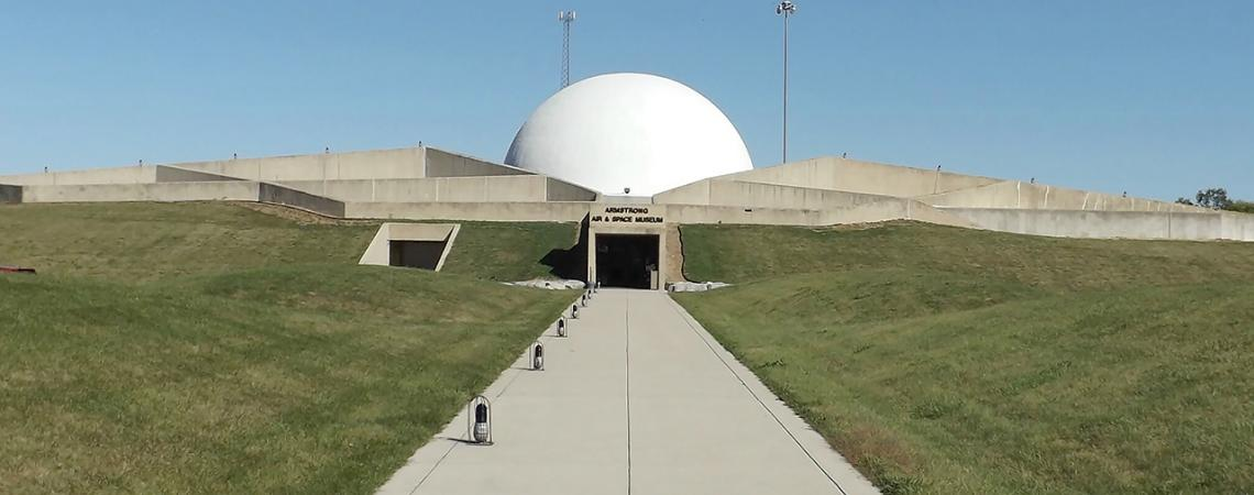 An outside view of the Armstrong Air and Space Museum, which resembles a moon base.