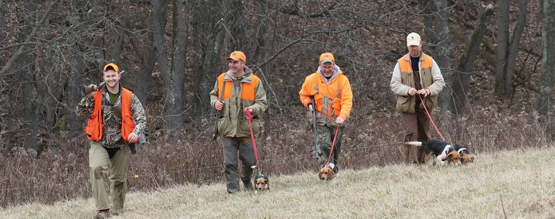 Four guys holding on to what is becoming a lost art: Scott Lynch, Dave Miller, Greg Thomas (also shown at left), and Rick Truman, hunting with their beagles.