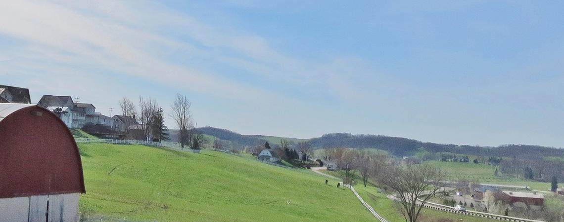 A photo of a barn and hill at Walnut Creek